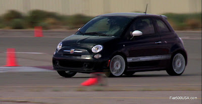 Black Fiat 500 Abarth on track