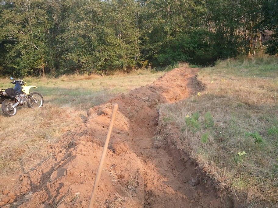 A Swale on contour to keep water on the land, the berm will be our first row of trees.