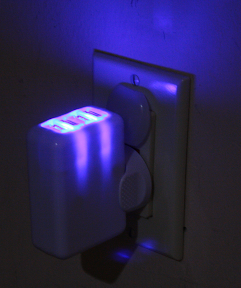 The KMS 4-port USB charger emits an eerie blue glow when in use.