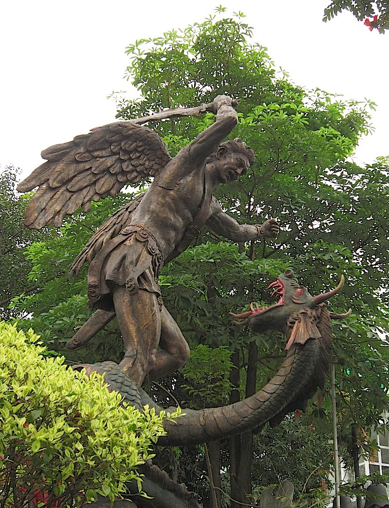 sculpture of Saint Michael slaying the serpent