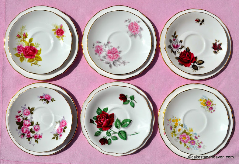 Mismatched vintage saucers with beautiful roses