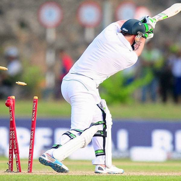 South Africa cricketer AB de Villiers is dismissed by Sri Lankan cricketer Suranga Lakmal during the first day of the opening Test match between Sri Lanka and South Africa at the Galle International Cricket Stadium in Galle on July 16, 2014.