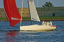 J/70 one-design sailboat- girls team sailing off Newport