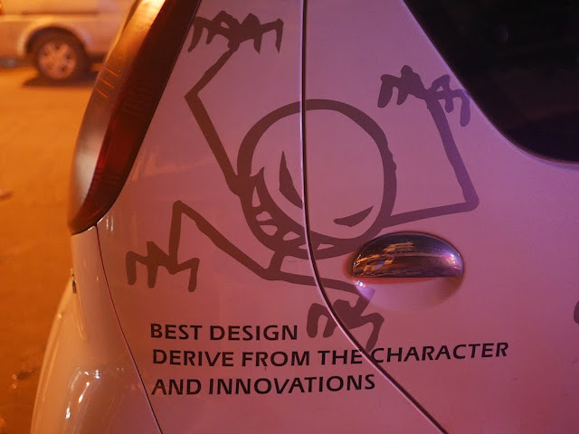 "car with design of a stick figure monster and the words ""Best design derive from the character and innovations"""