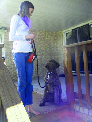 Katharine and Alfie at the top of the stairs coming off the back deck; he's sitting, watching her