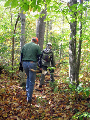 Doug and Chip headed toward relocation site near Middlebury College's Snow Bowl ski trail.