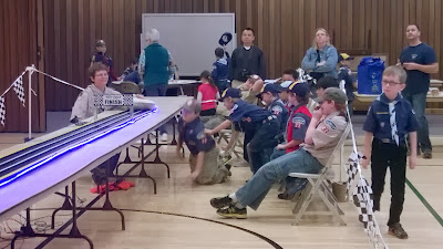 Cub scouts eagerly awaiting the race