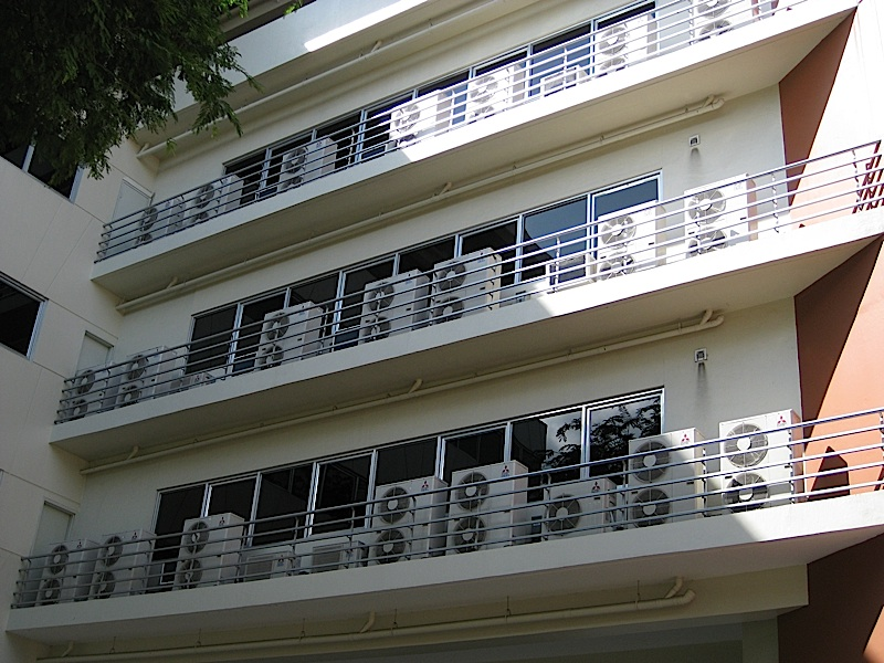 a wall full of the external packages of split-type air conditioners