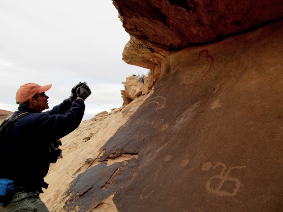 Alan photographing the rock art