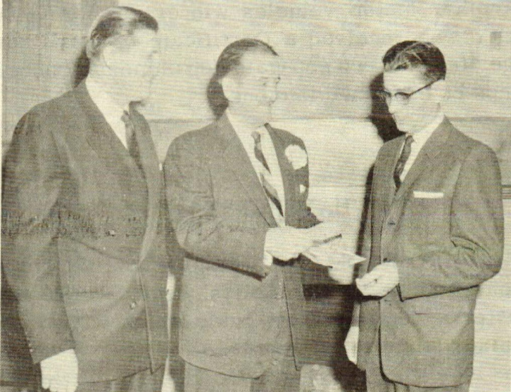 Dr. Dean K. Brooks, Governor Robert Holmes and Thomas Mommsen accepting award.  The Suggestor.  May 1958.