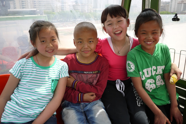 four kids in a cable car in Lanzhou, Gansu