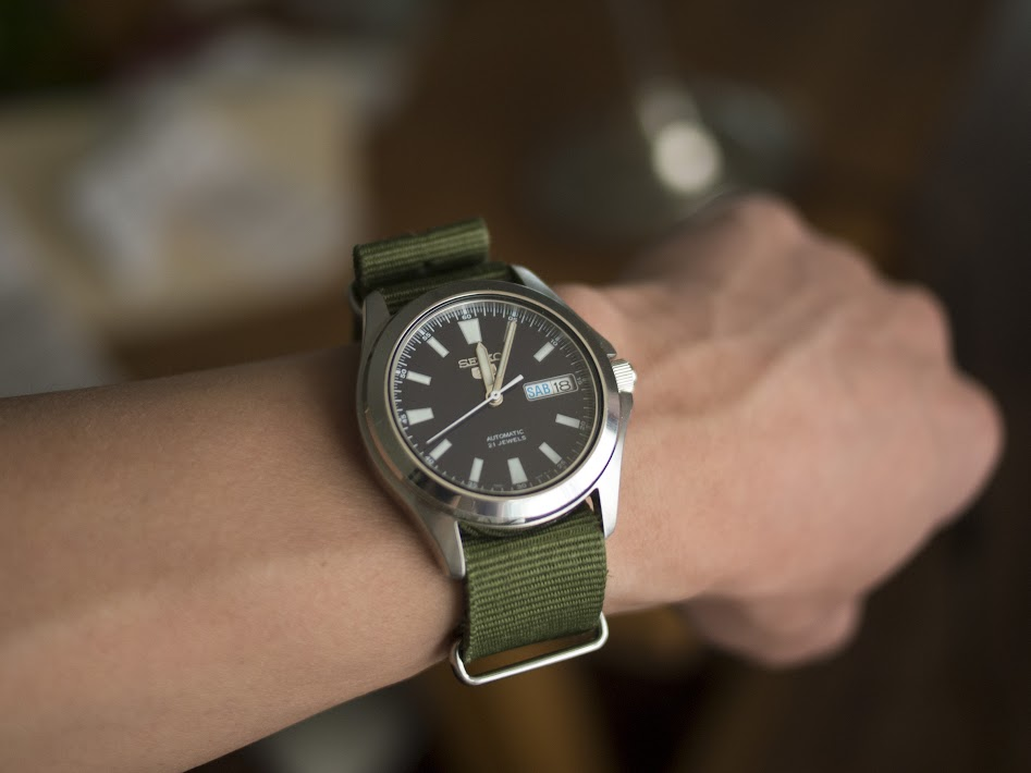 The SNKL07 on an olive nylon strap.