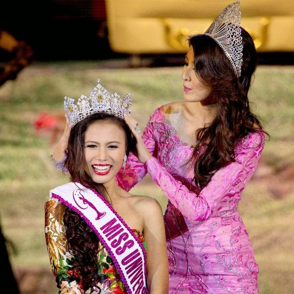 Miss Universe Myanmar 2014 Sharr Htut Eaindra, left, is crowned by Miss Universe Myanmar 2013 Moe Set Wine, right, during a pageant in Yangon, Myanmar, Saturday, July 26, 2014.