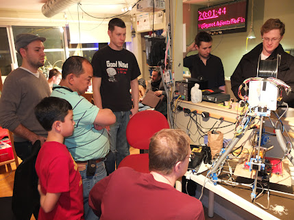 Attendees of the third Toronto RepRap meetup look at a giant Mendel.