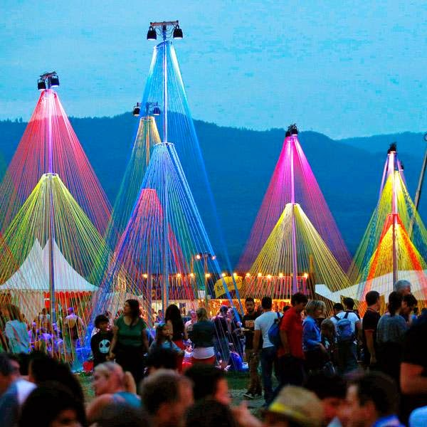 Revellers walk past an art installation during the 39th Paleo Festival in Nyon July 23, 2014.