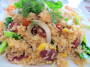 Kao Pad Kun Chiang, a dish of fried rice with egg, Chinese sausage, onion, tomato and Chinese broccoli Manao PDX Thai restaurant Portland Chef Chew