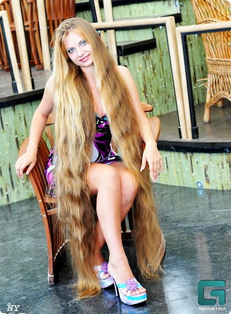 Lovely model with very long hair photo pictures
