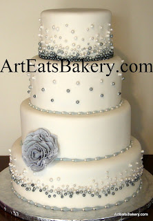 Four tier white fondant wedding cake with modern gray and white edible pearls and flower design