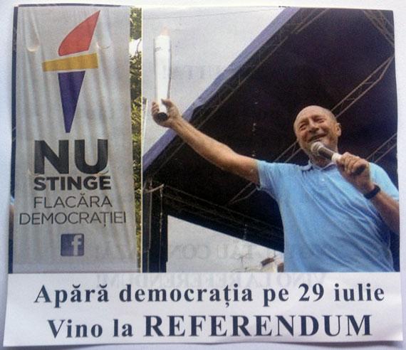 Flacăra lui Băsescu, folosită pe pliantele USL pentru referendum