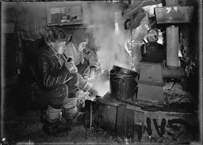 Dog handler Cecil Meares and Captain Lawrence Oates (1880 - 1912) cook blubber for the dogs at their camp in the Ross Dependency of Antarctica, during Captain Robert Falcon Scott's Terra Nova Expedition to the Antarctic, May 1911. (Photo by Herbert Ponting/Scott Polar Research Institute, University of Cambridge/Getty Images)