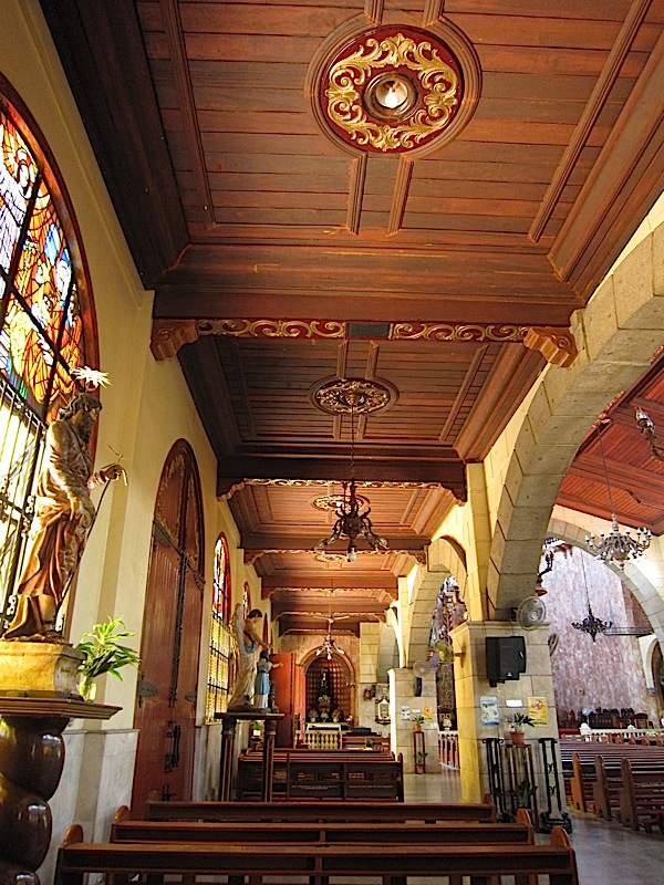 left aisle and wooden ceiling of the Agoo Basilica