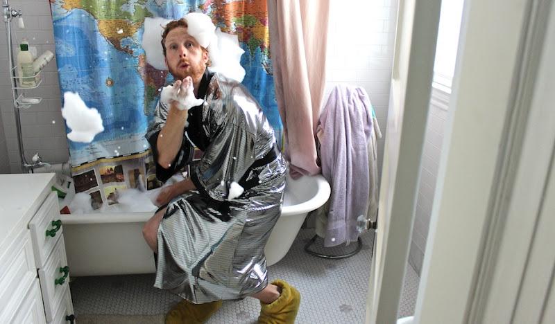 Tyler Disco Kimono blowing soap bubbles