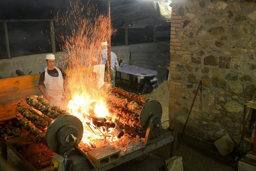 The galletto (rooster) grilling at Camigliano's autumn food festival