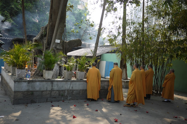 monks praying at Kun Iam Temple in Macau