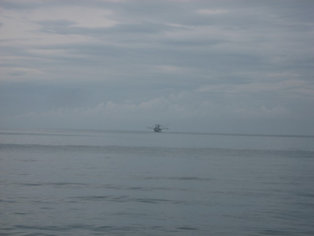 Southern Style, a commercial fishing vessel, anchored of f Water Cay