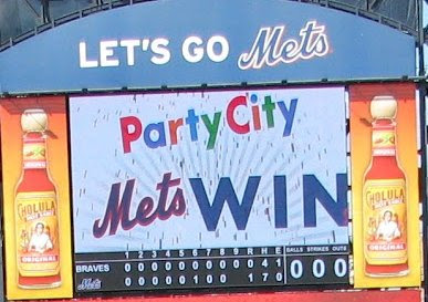 The scoreboard display after a 2012 Mets victory