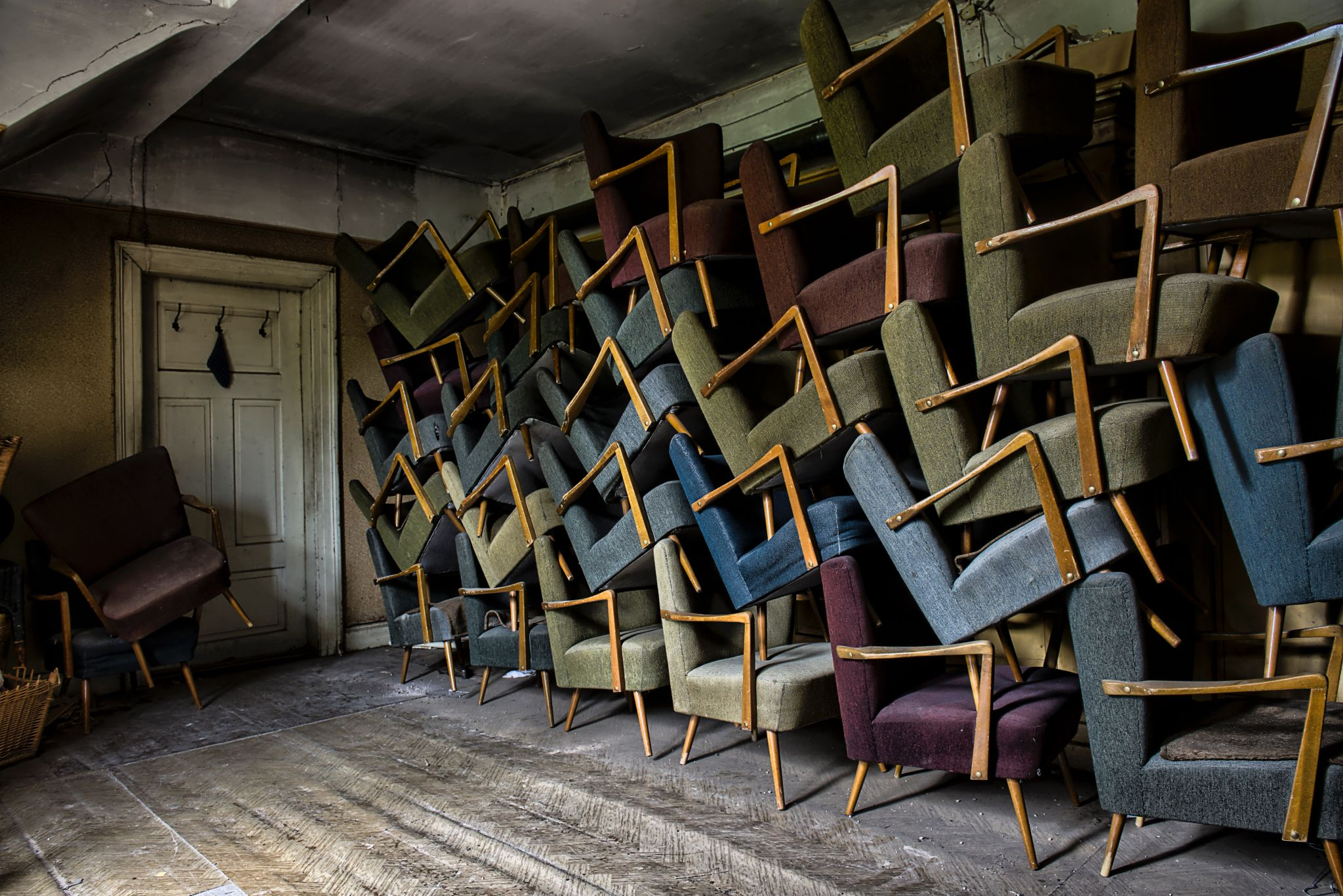 Room with many stacked arm chairs on one side
