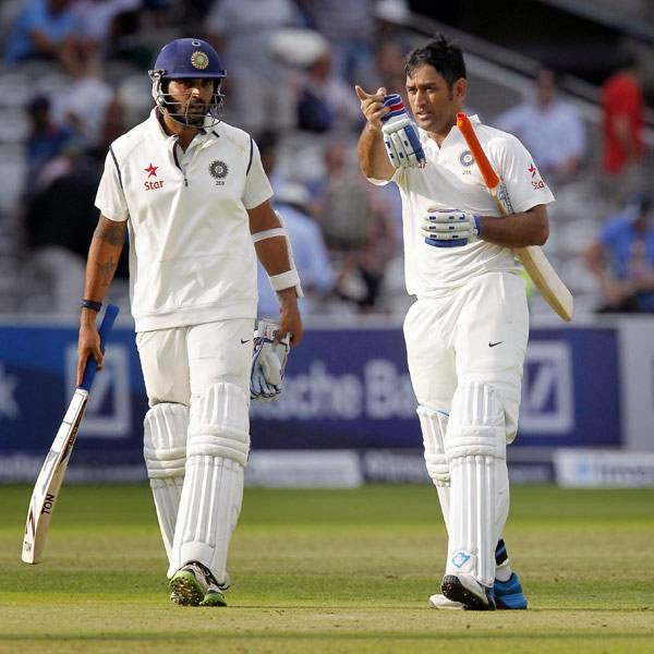 India's Murali Vijay (L) and India's Captain MS Dhoni walk off at the end of the play during play on the third day of the second cricket Test match between England and India at Lord's cricket ground in London on July 19, 2014.