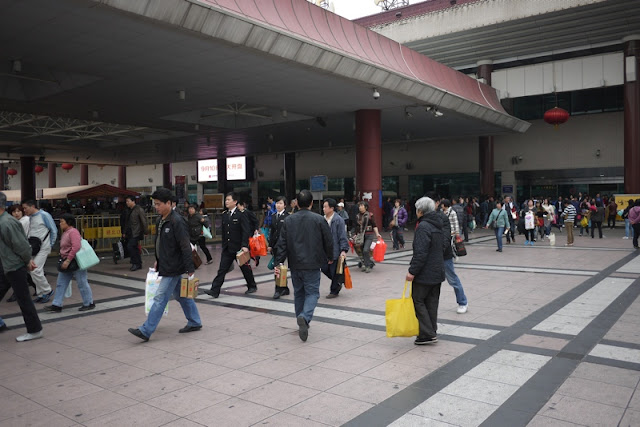 people exiting the Macau border control building in Zhuhai