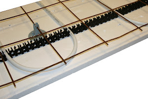Golvvärme ingjuten i betong med rörhållarskenor och golvvärmerör