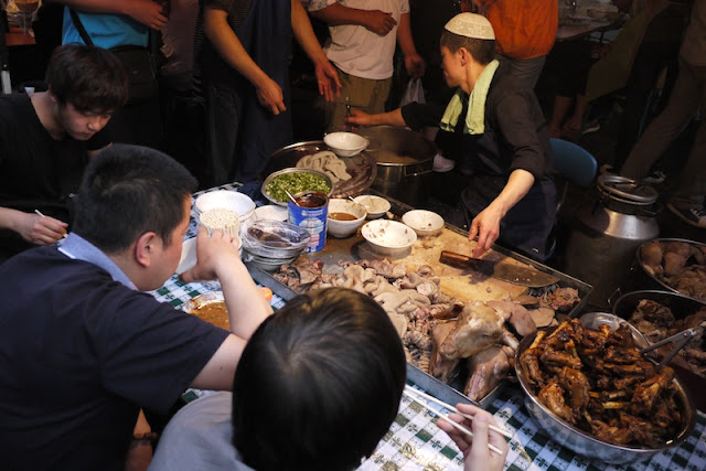 serving a variety of lamb parts at Zhengning Street Night Market in Lanzhou, China