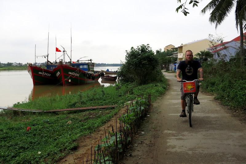 Riding past fishing boats