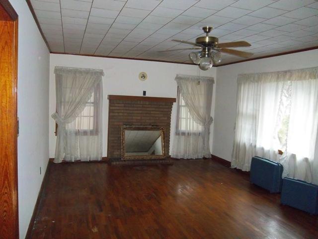 Hardwood floors, fireplace in living room.