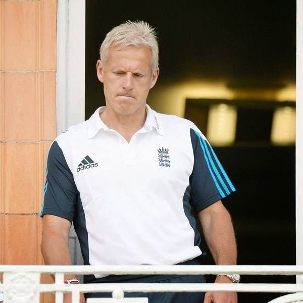 England's coach Peter Moores looks on from the dressing room balcony after India won the second cricket test match at Lord's cricket ground in London July 21, 2014.