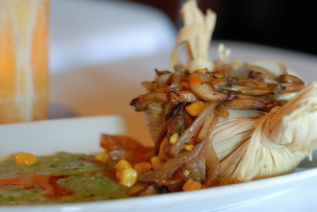 A close up of a plate of food, with Santa Fe and La Casa Sena