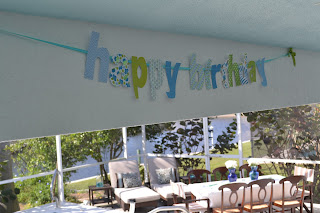 This floral birthday banner is festive for the celebration.