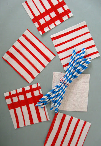 finished coasters, accompanied by striped paper straws