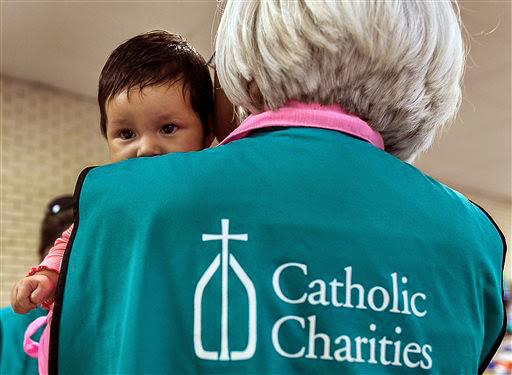 Catholic charities open arms to illegal immigrants