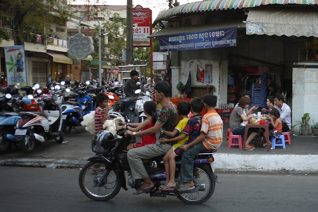 man and four children on a motorbike