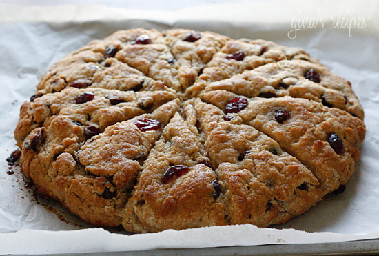 Fresh baked lemon scented scones studded with cranberries, topped with ...