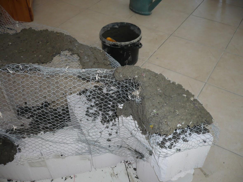 le rocher fauteuil et les premi res scultures mur rocheux et bassin malawi de 700l. Black Bedroom Furniture Sets. Home Design Ideas
