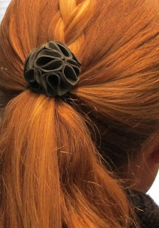 leather flower hair tie on ponytail
