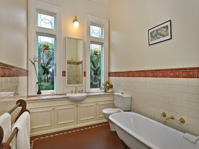 This is a classic modern Federation bathroom with an updated handbasin, totally in Federation style. The beautiful stained glass looks to illustrate Strelitzia, a common name of the genus is bird of paradise flower / plant, because of a resemblance of its flowers to the bird of paradise. In South Africa it is commonly ‎Strelitzia reginae.