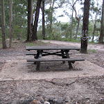 The picnic table and campfire
