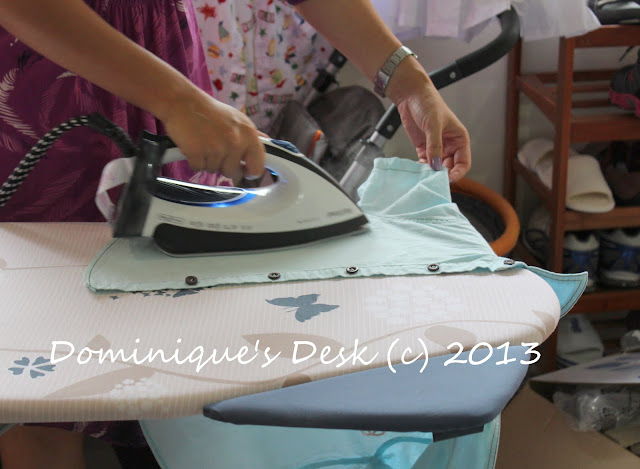 Ironing one of the boys shirt