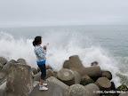 Wave splashes at Santa Cruz Harbor Lighthouse